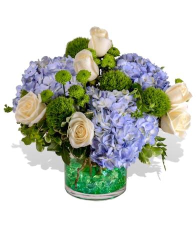 Colorful flowers in a gem-filled vase delivered in Baton Rouge.