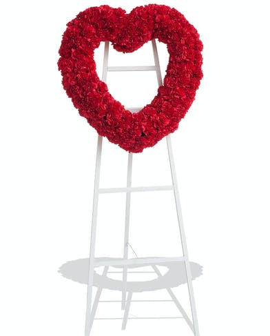 Classic Carnations heart stand delivered in Baton Rouge, LA.