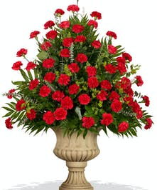 Classic Carnations urn arrangement delivered in Baton Rouge, LA.