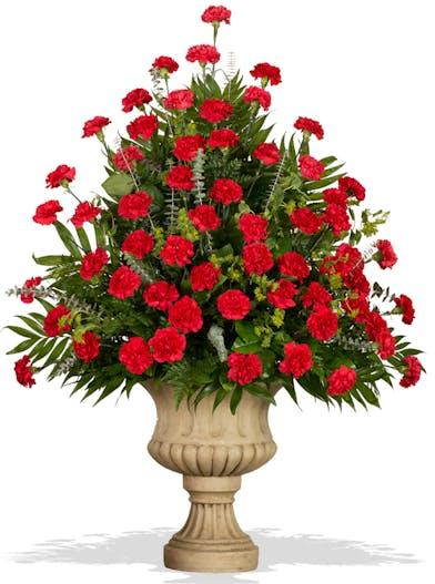 Classic Carnations urn arrangement delivered in Baton Rouge, LA.