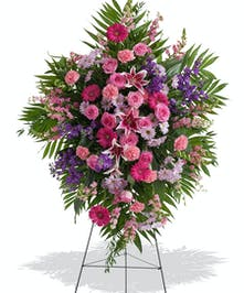 Traditional Standing Funeral Spray in Feminine Pink and Purple Florals delivered in Baton Rouge