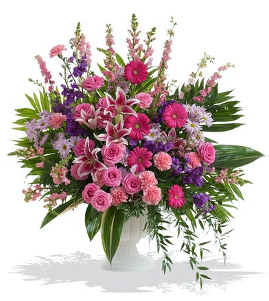 Urn Arrangement for the head or foot of the casket with Feminine Pink and Purple Florals delivered baton rouge LA