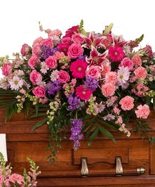 Casket cover in Feminine pink and purple florals delivered in Baton Rouge, La