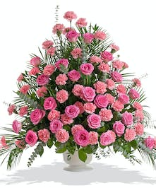 Arrangement in Urn made of Roses and Carnations colors of your choice delivered baton rouge LA