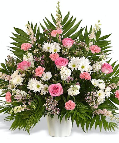 pink and white funeral basket arrangement delivered baton rouge la