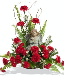 Classic Carnations small floor piece with angel delivered in Baton Rouge, LA.