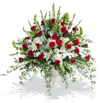 Red and White Tradition urn arrangement delivered in Baton Rouge, LA.