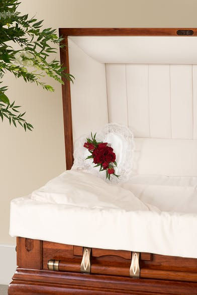 Red and White Tradition casket pillow delivered in Baton Rouge, LA.