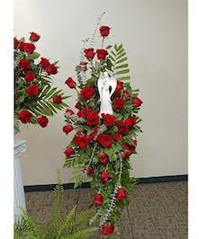Reverent Roses stand arrangement delivered in Baton Rouge, LA.