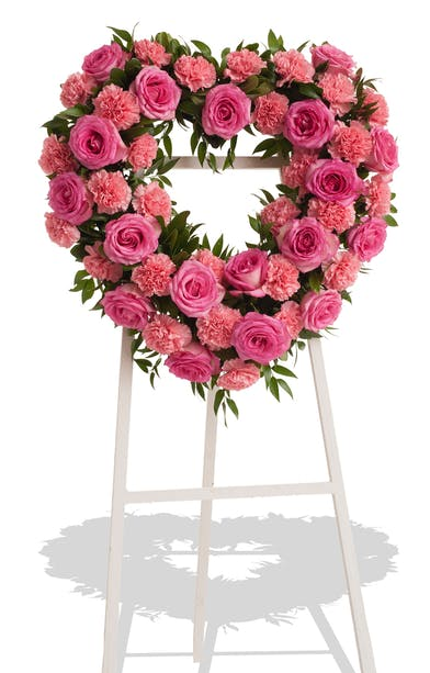 Sympathy Heart Standing Spray with Roses and Carnations in the colors of your choice