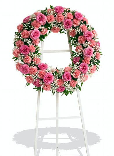Standing Wreath made of Roses and Carnations colors of your choice delivered baton rouge LA