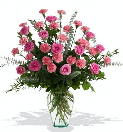 Roses and Carnations in the colors of your choice in a vase delivered to the service in Baton Rouge LA