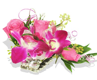 orchid and rose wristlet corsage for the dance in Baton Rouge LA