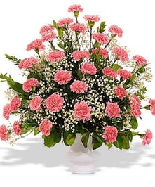 any color carnation funeral desgin in an urn delivered in baton rouge la