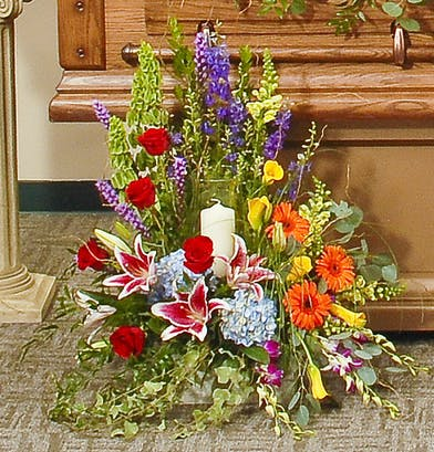 Vivid beauty memorial candle arrangement delivered in Baton Rouge, LA.