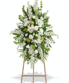 White and Green flowers on traditional standing funeral spray delivered Baton Rouge LA