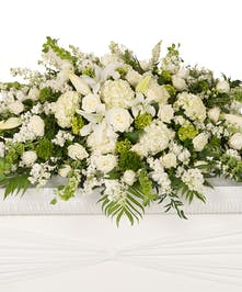White and Green flowers for the casket delivered Baton Rouge