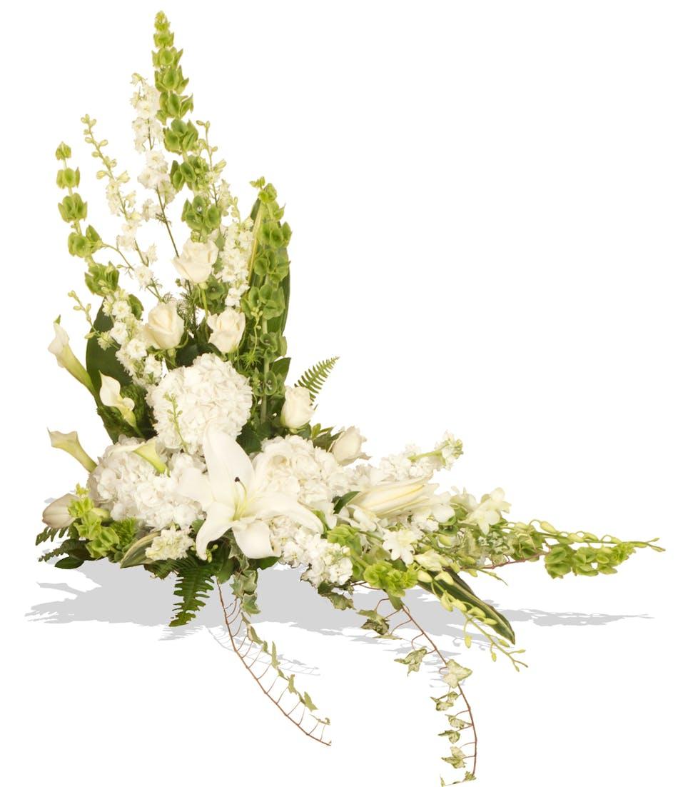 Elegant white cremation sidepiece arrangement delivered in baton white and green arrangement to go on sides of cremation urn delivered in baton rouge mightylinksfo