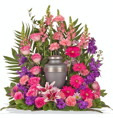 Pink and Purple Feminine flowers designed as a wreath for Cremation Urns delivered baton rouge LA