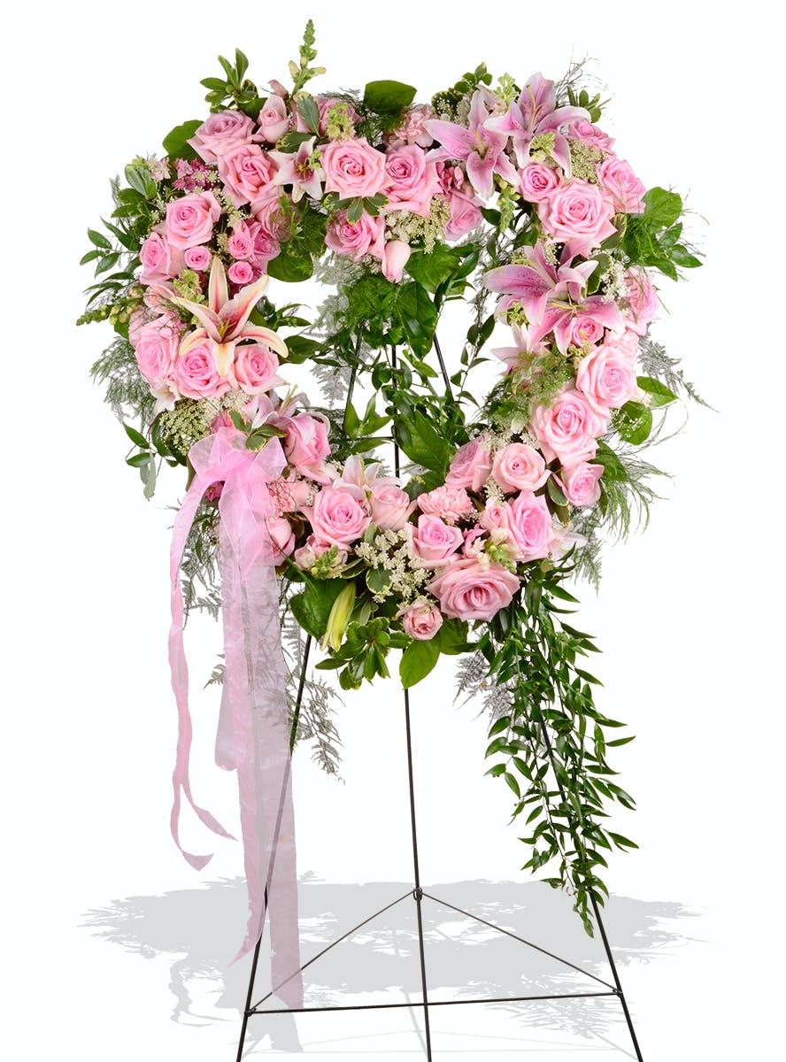 feminine heart standing funeral spray delivered in baton