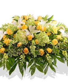 Casket cover with green yellow and white flowers delivered baton rouge LA