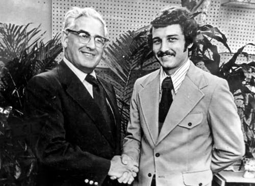 Billy and son share a handshake in the early 1980s