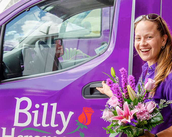 One of our drivers heads out in a purple van to deliver a gorgeous purple and pink bouquet